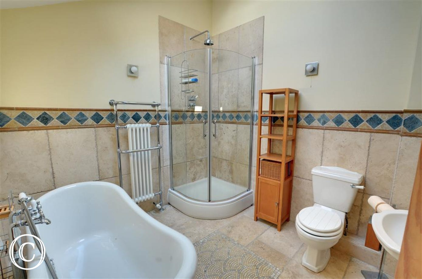 Downstairs luxury bathroom with slipper bath and shower cubicle