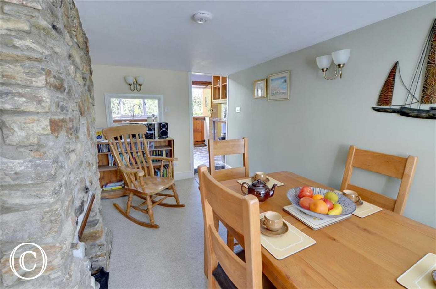 One step down takes you to the dining area leading through to the attractive kitchen