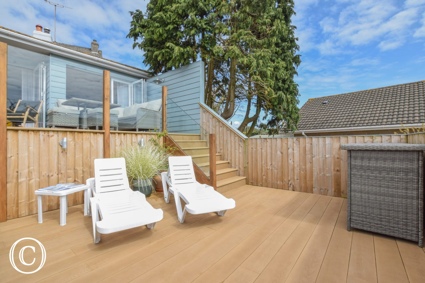 Decking area with sun loungers, great for a BBQ and relaxing in the evening