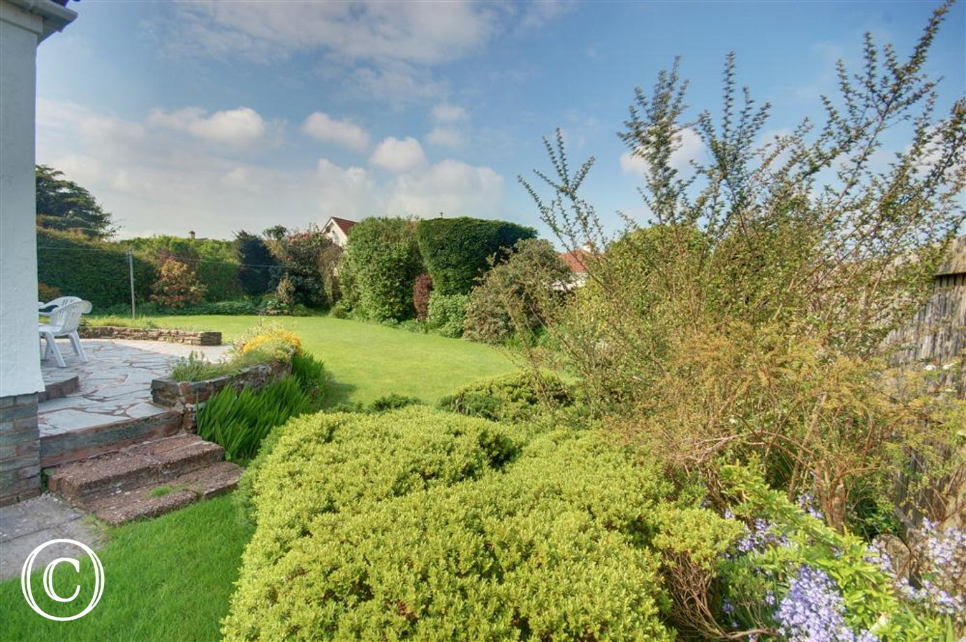 Beautiful extensive gardens surround the property