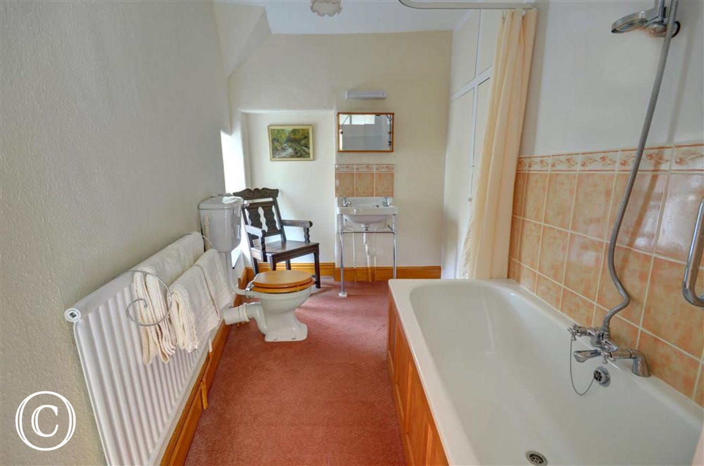 Bathroom with double ended bath, shower over bath, WC and basin