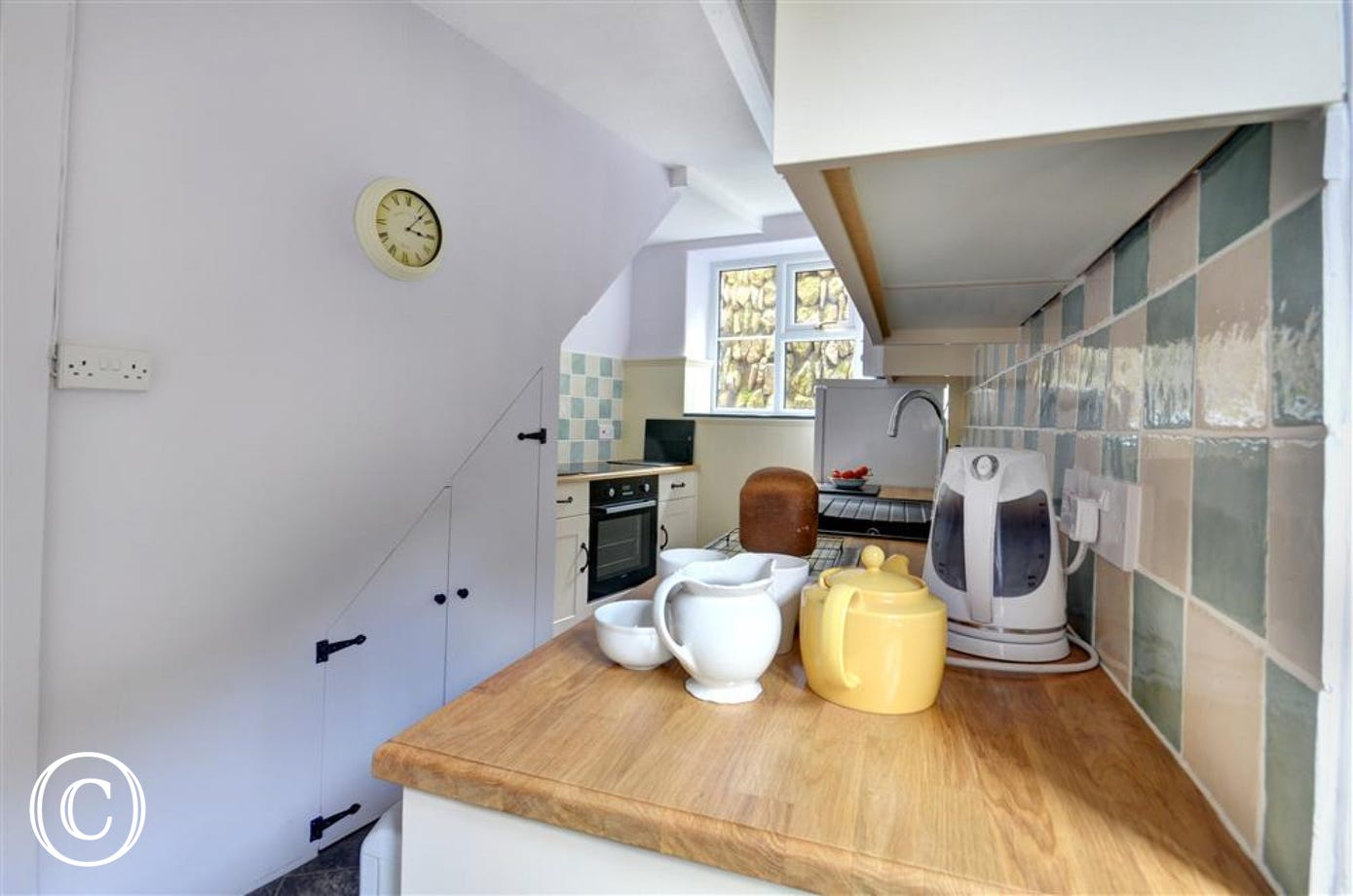 A well equipped kitchen at the rear of the property provides all you will need for dining in