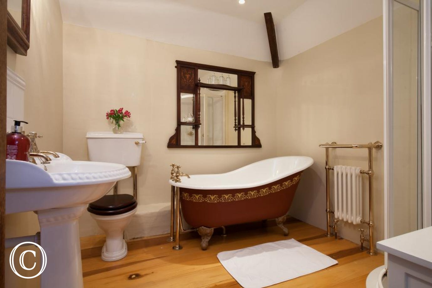 A Traditional Family Bathroom with roll top Bath and Separate Shower cubicle