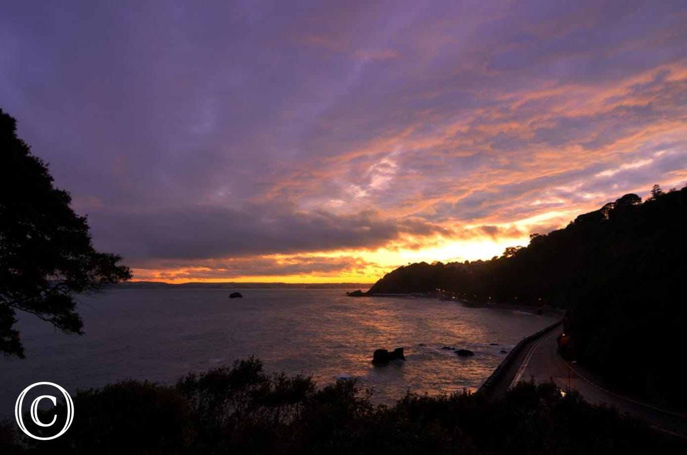 Sunset over Meadfoot beach from Kilmorie Studio