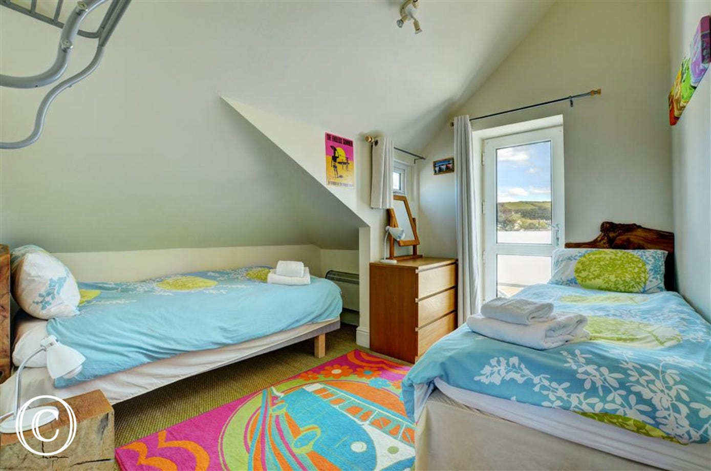 The brightly decorated twin room benefits from a patio door to the balcony