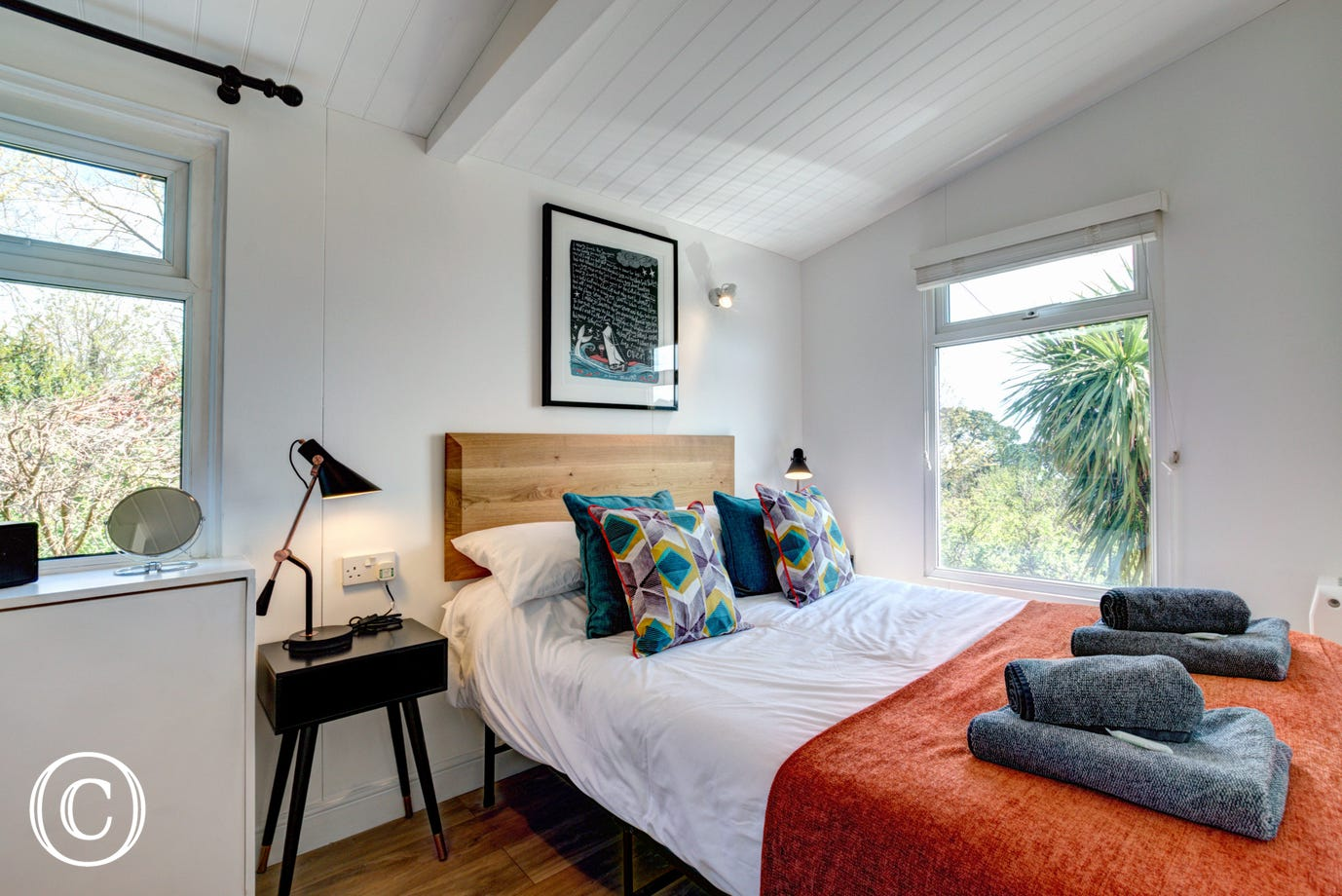Bedroom: Double bed with views out sea. Stylish and coordinated bedroom, bedside tables and lamps. Separate dressing area with ample storage for clothes, full length mirror. Analogue Radio.