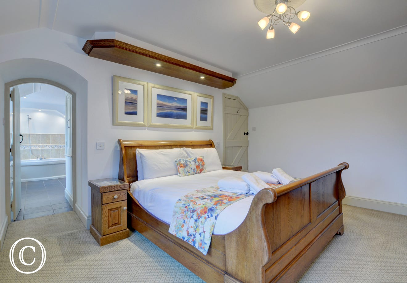 The master bedroom with a sleigh style bed