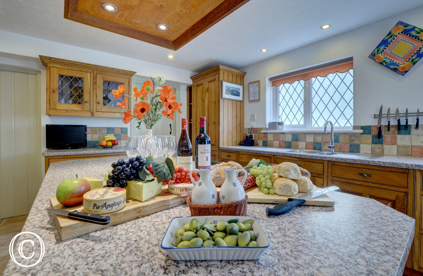 The large kitchen is extremely well equipped and has plenty of space for preparing family meals