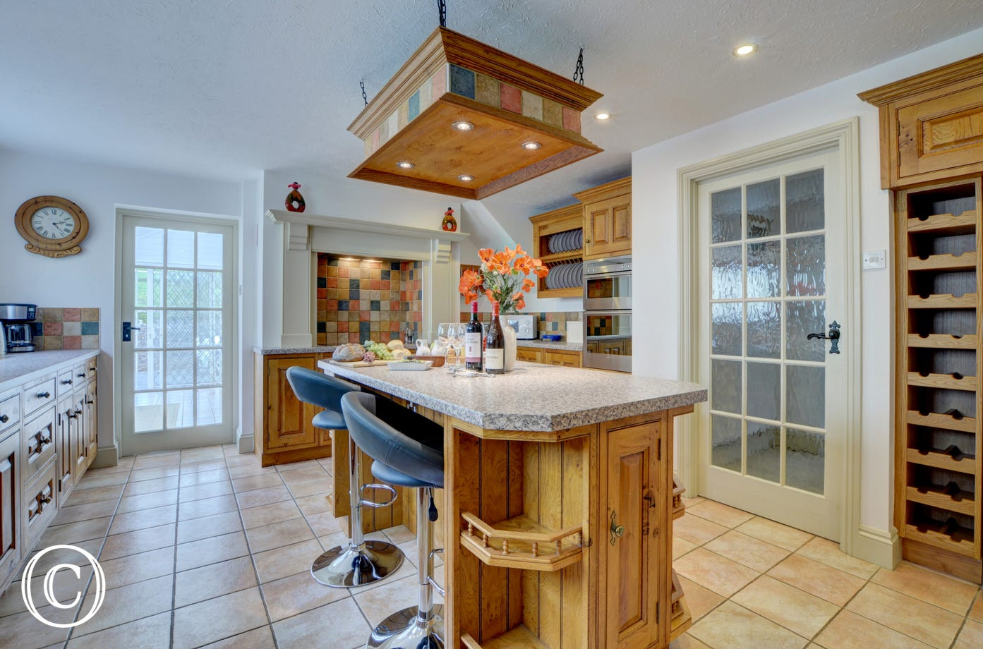 The kitchen has a useful island with bar stools