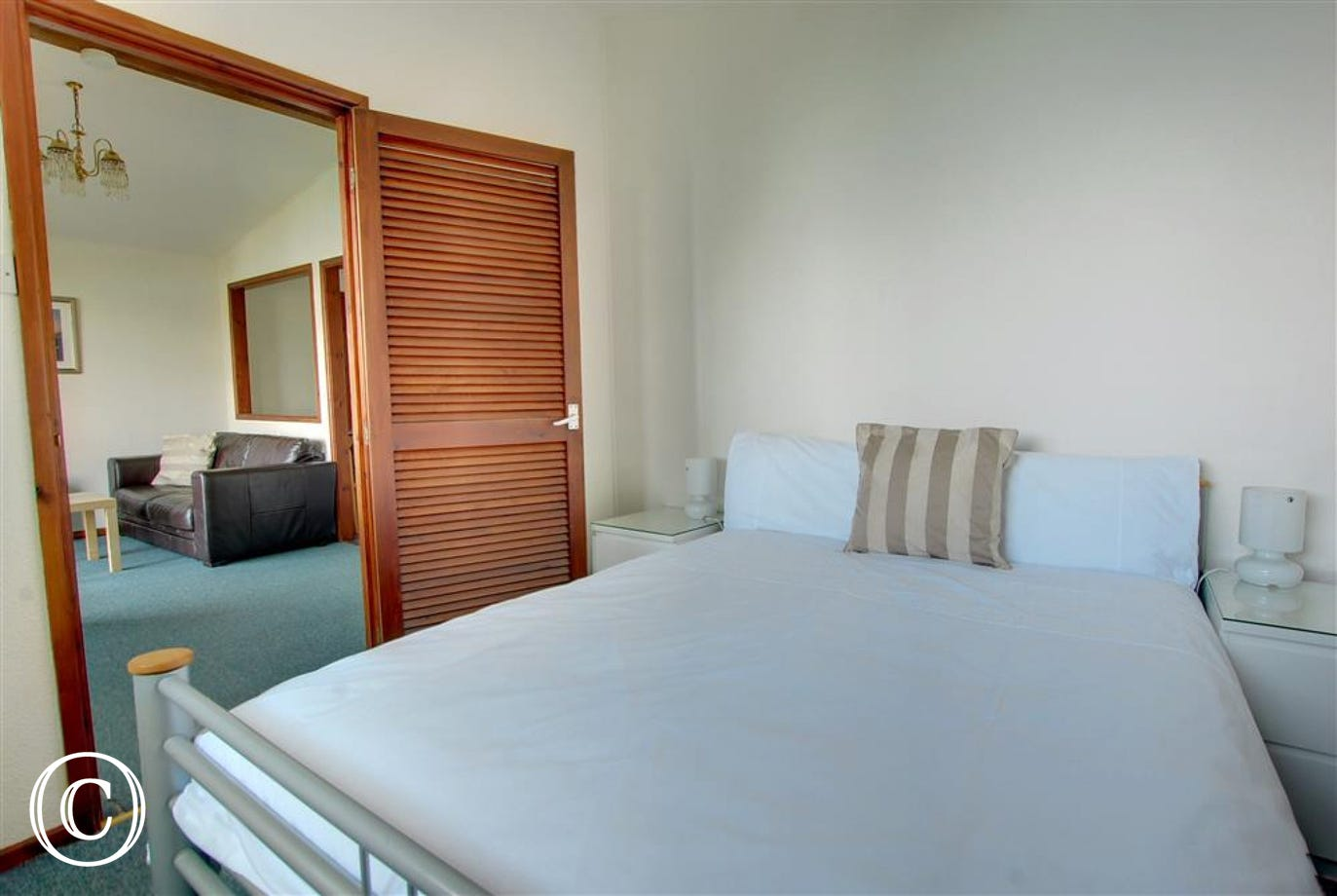 Simply furnished compact double bedroom