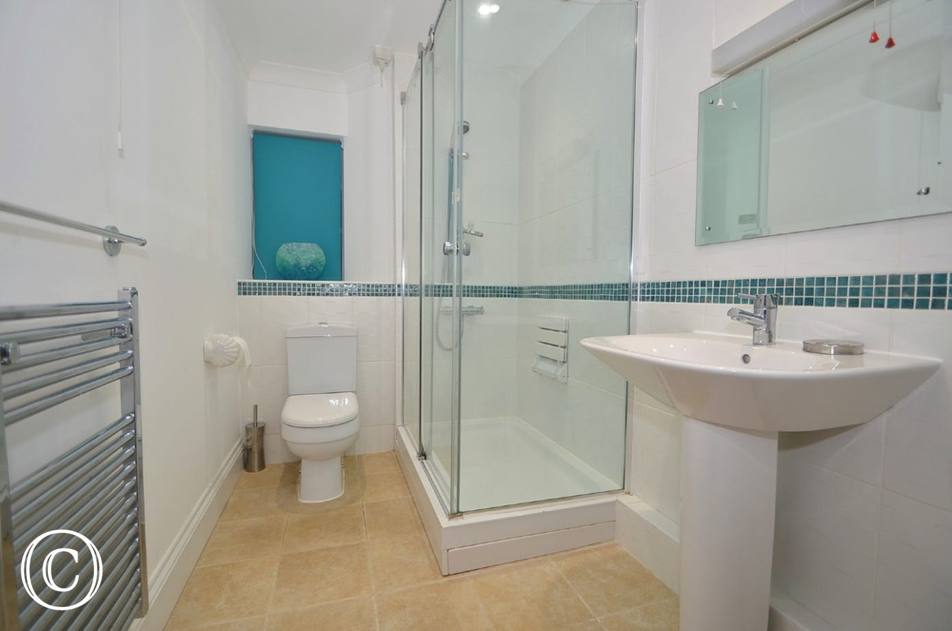 First floor bathroom for master and bedroom 2: Large walk in shower, WC, sink with overhead mirror and a heated towel rail.