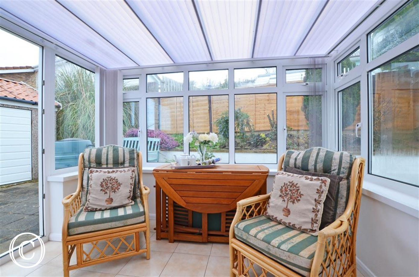 The conservatory adds extra space to relax and has access to the patio and garden