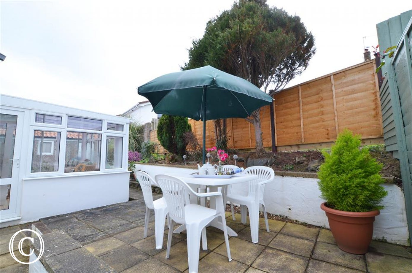 Enclosed patio with garden furniture