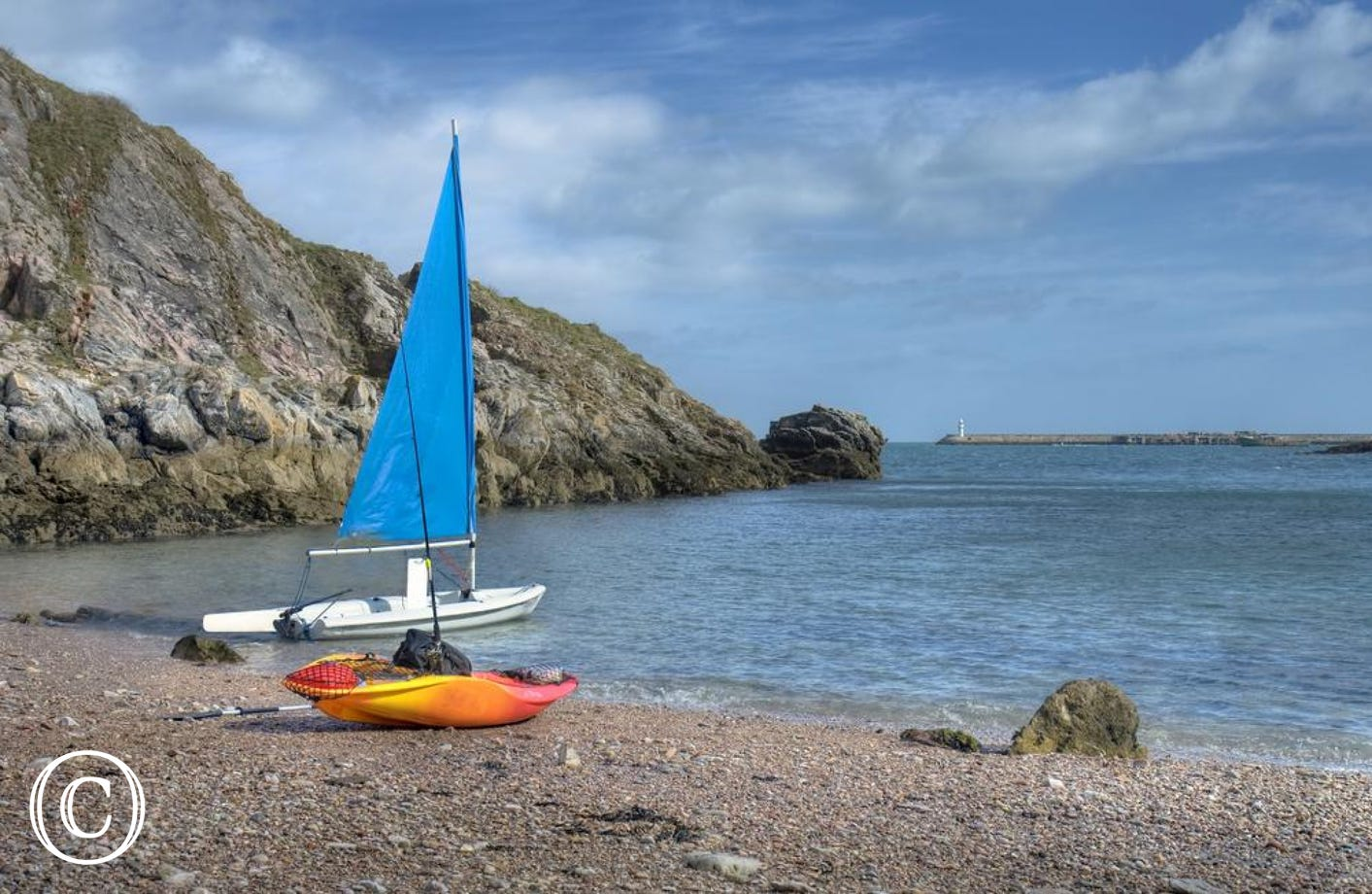 Torbay coastline with sail boat on the beach