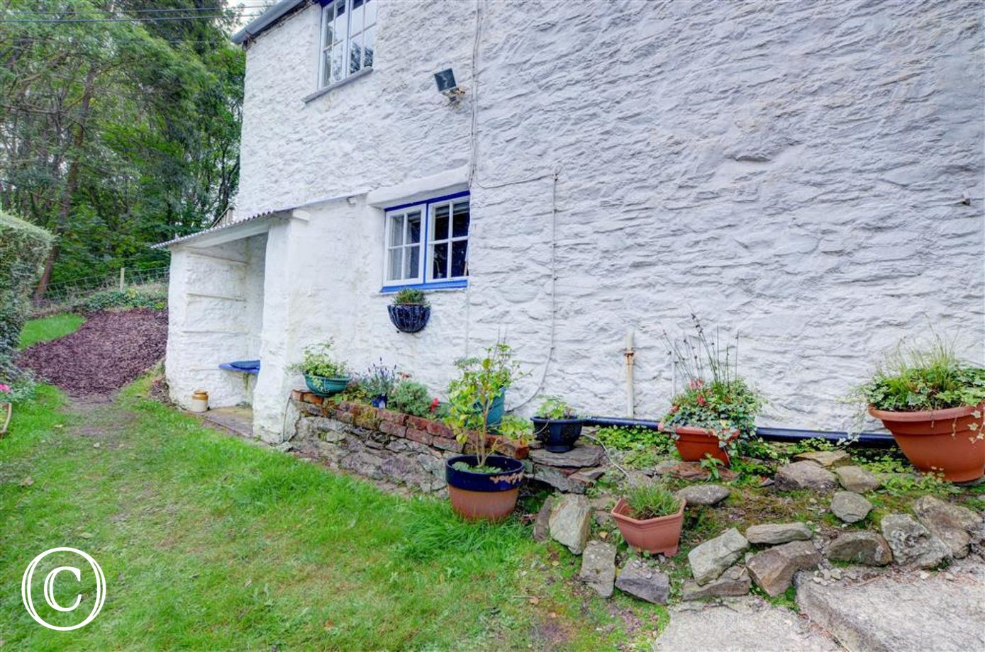The cottage's garden is enclosed with a small sloped lawn area and offers you another place in which to unwind