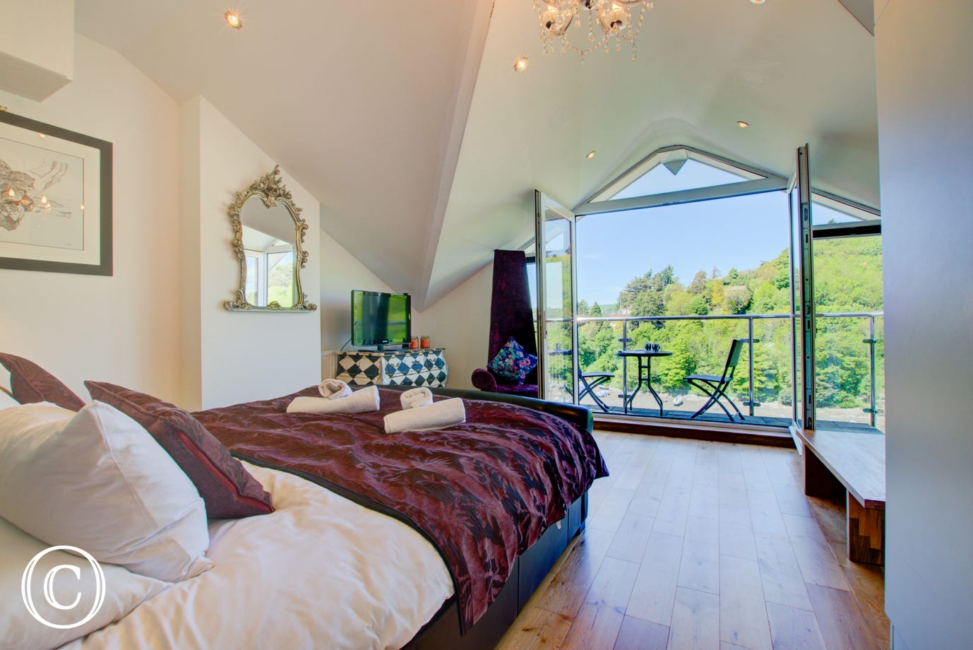 Bedroom 4: Super King size bed with sitting area, kitchen with  table and chairs and balcony with wonderful panoramic views out over the creek and across to Dartmouth