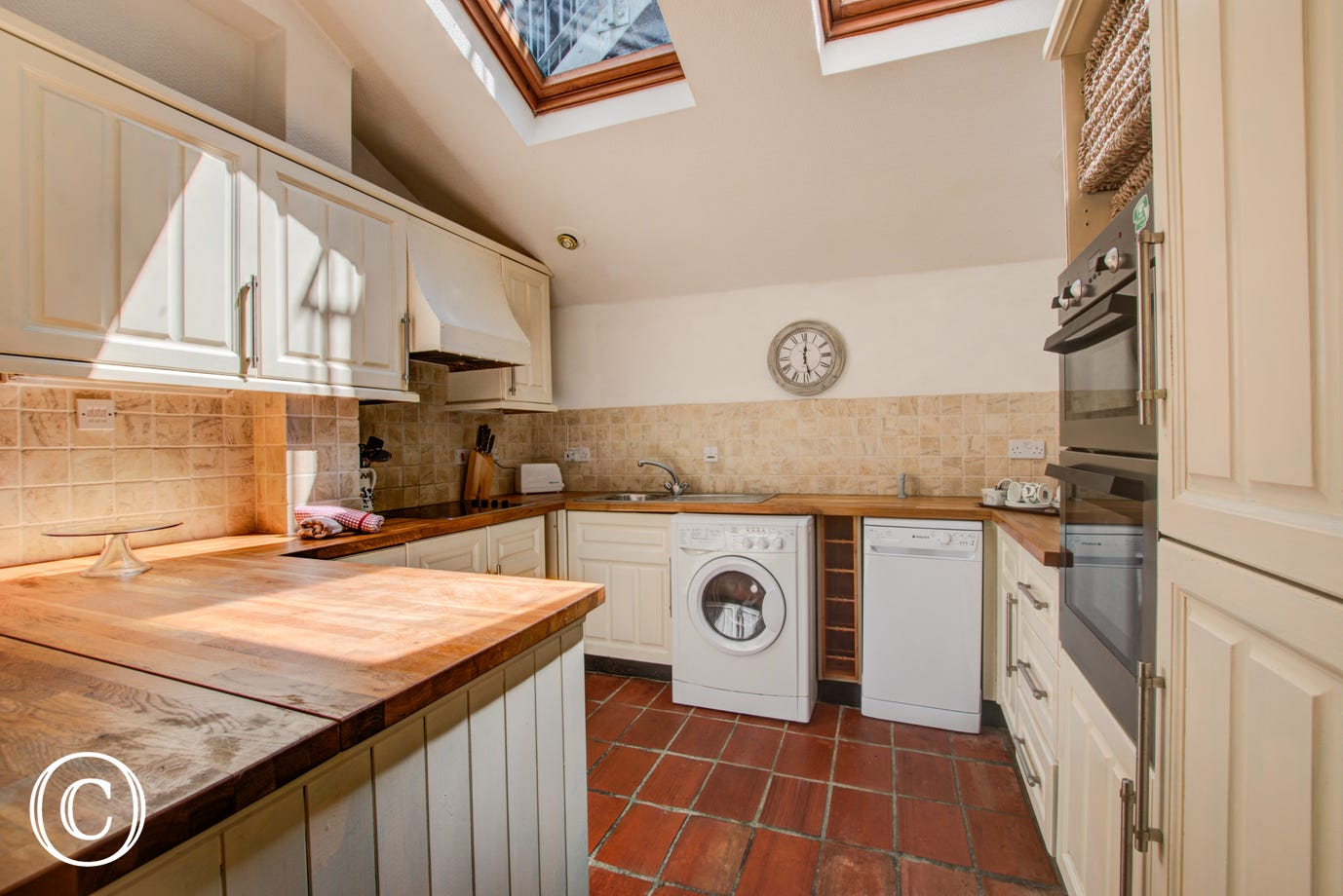 Kitchen: Modern kitchen tiled throughout with up to date appliances, electric hob, double spacious oven, washing machine, toaster, microwave and dishwasher.