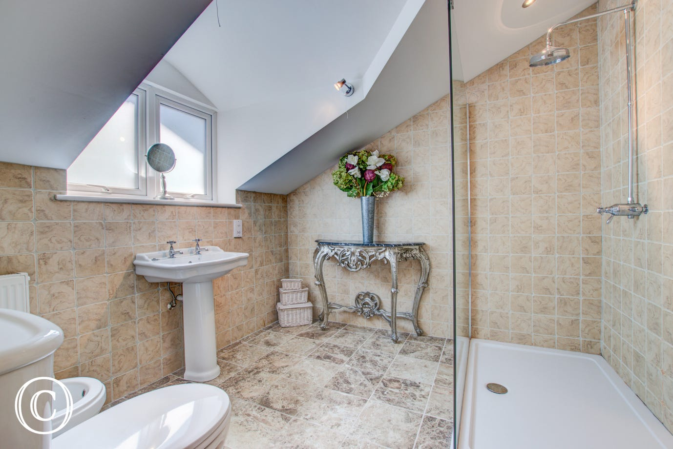 On the third floor in the apartment there is a bathroom with large walk in shower, WC, bidet and wash basin.