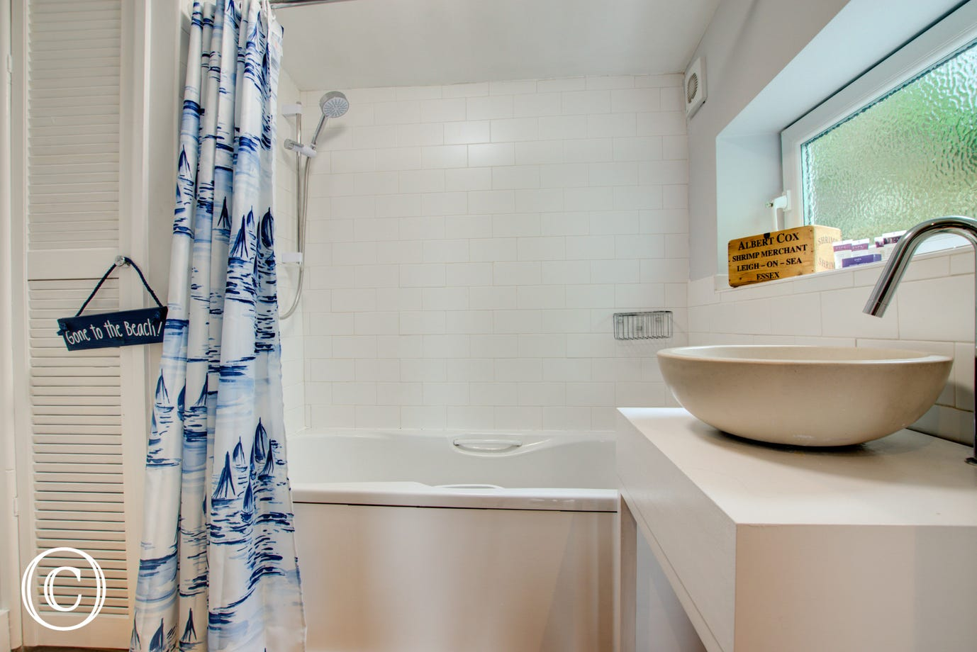 Bathroom: Located on the ground floor and comprises of a panelled bath with electric shower over, low level W.C. and a contemporary round washbasin set into a wooden vanity unit.