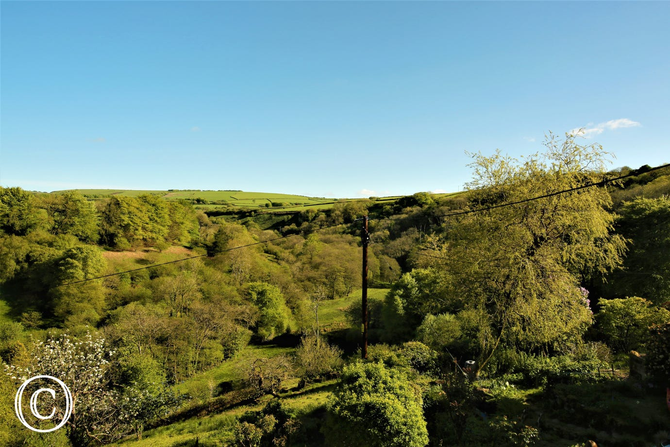 Magnificent views over the river Heddon and valley to the wooded hillsides beyond