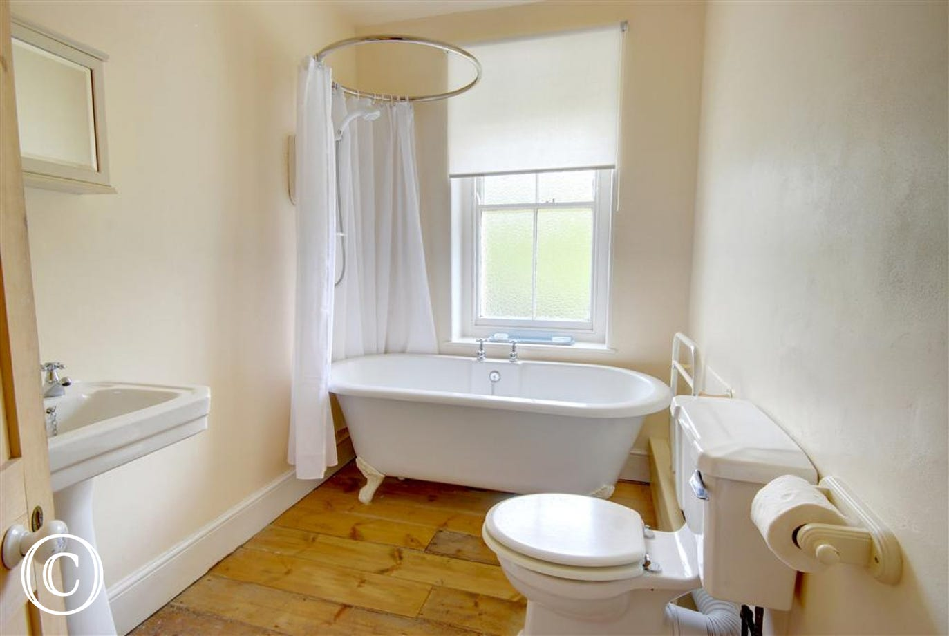 Good size family bathroom with double ended roll top bath and a fitted shower over the bath