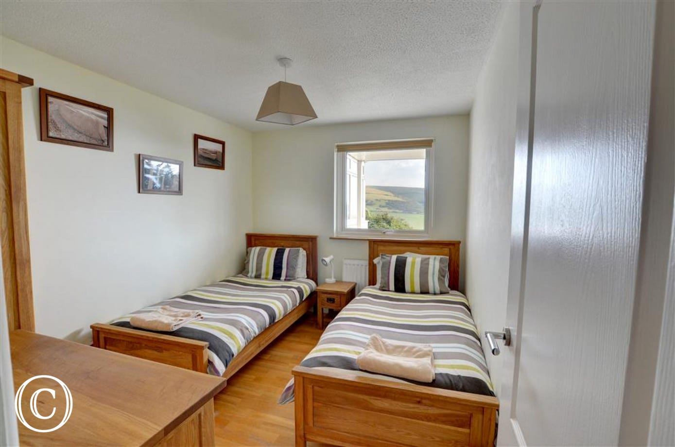 One of the twin bedrooms which has lovely views