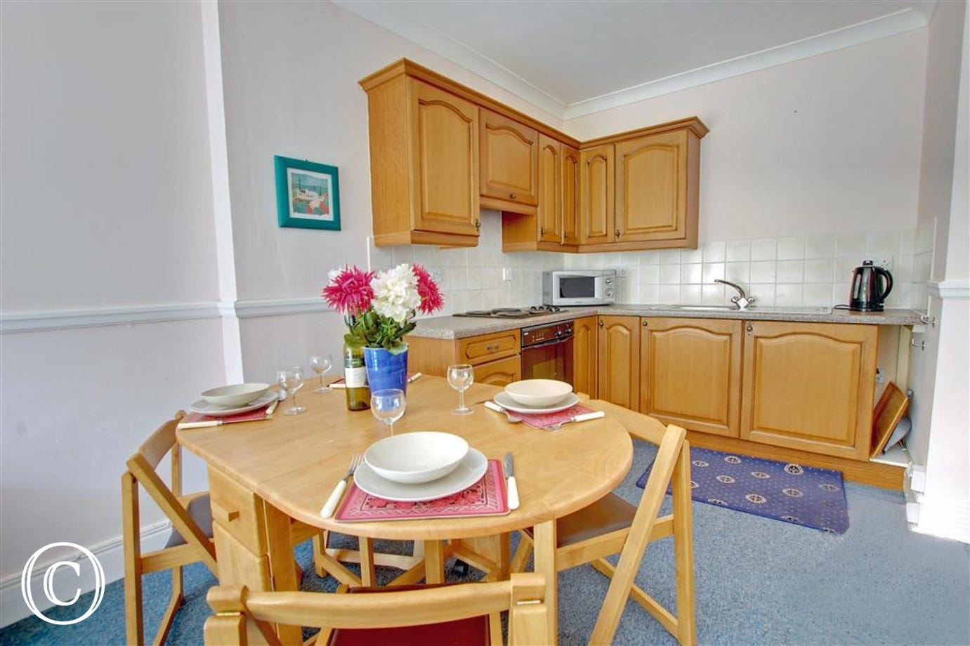 Compact fully fitted kitchen/dining area