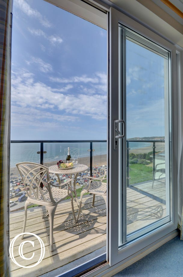The balcony has table and chairs so you can sit and soak up the stunning sea views