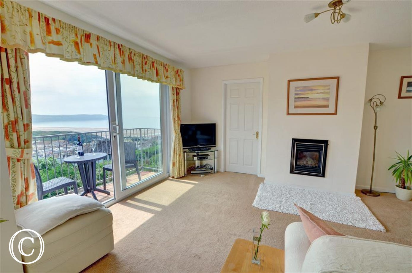 The sitting room with impressive views towards Woolacombe beach.