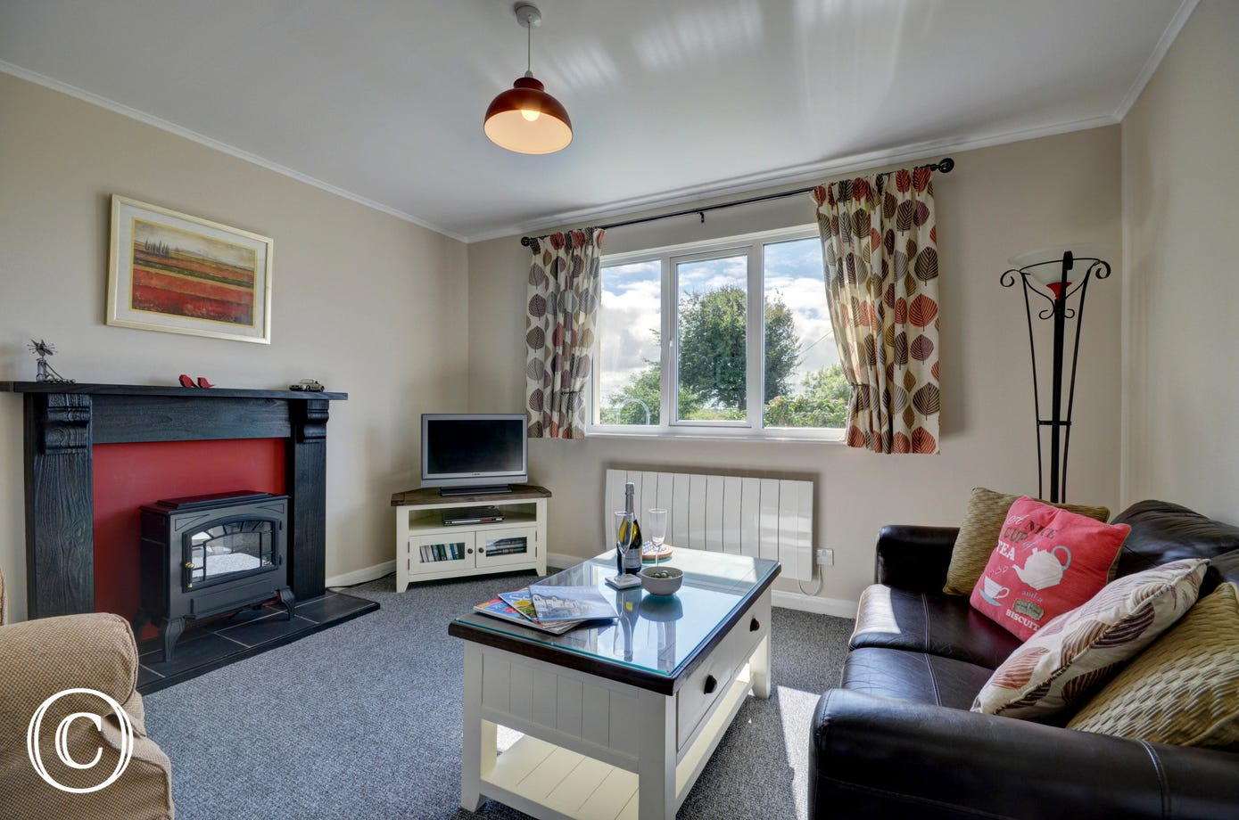 The comfortable lounge is spacious and bright and has views out to the Dartmoor hills in the distance