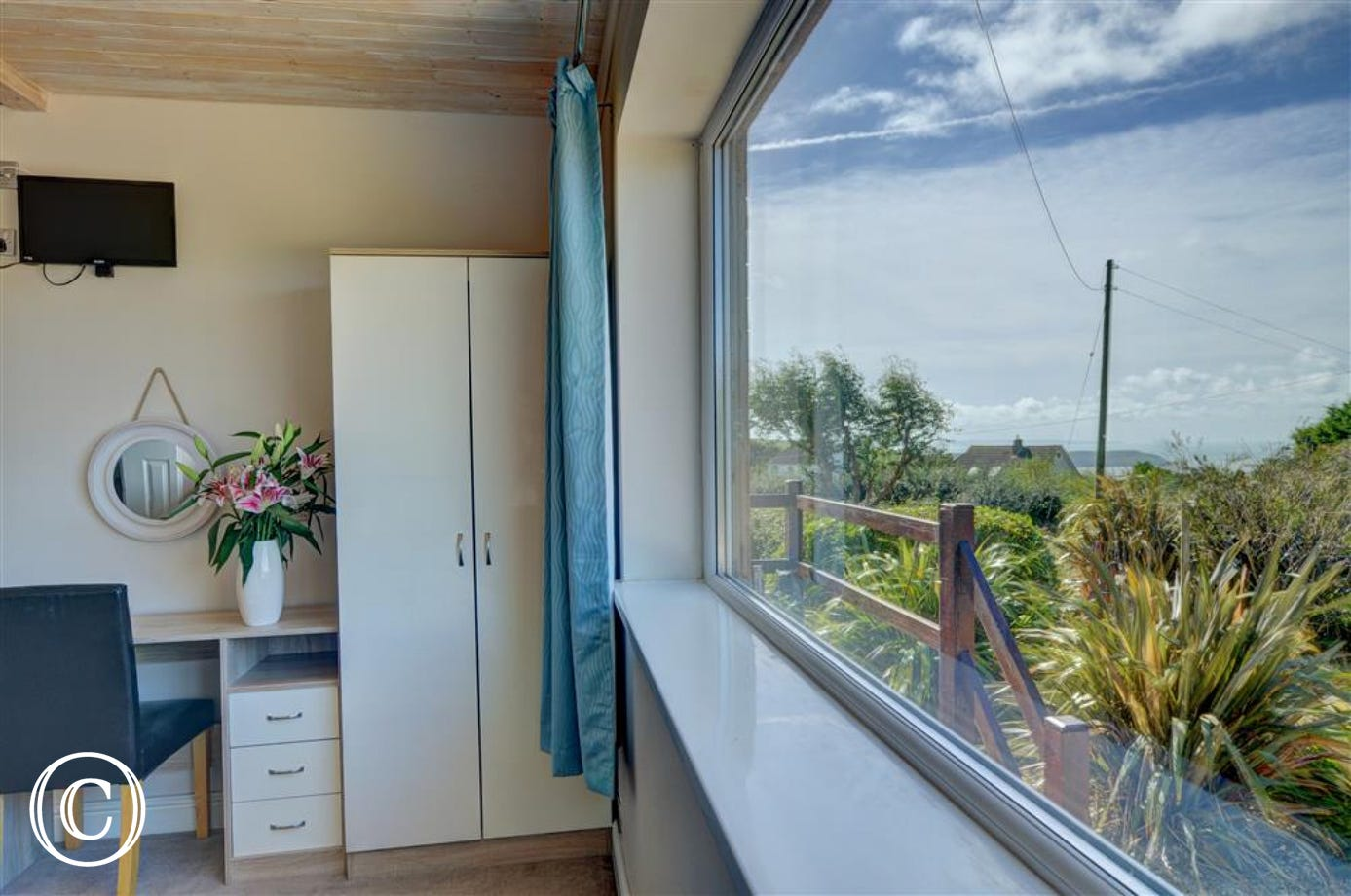 The double bedroom at the front of the property has lovely countryside and sea views