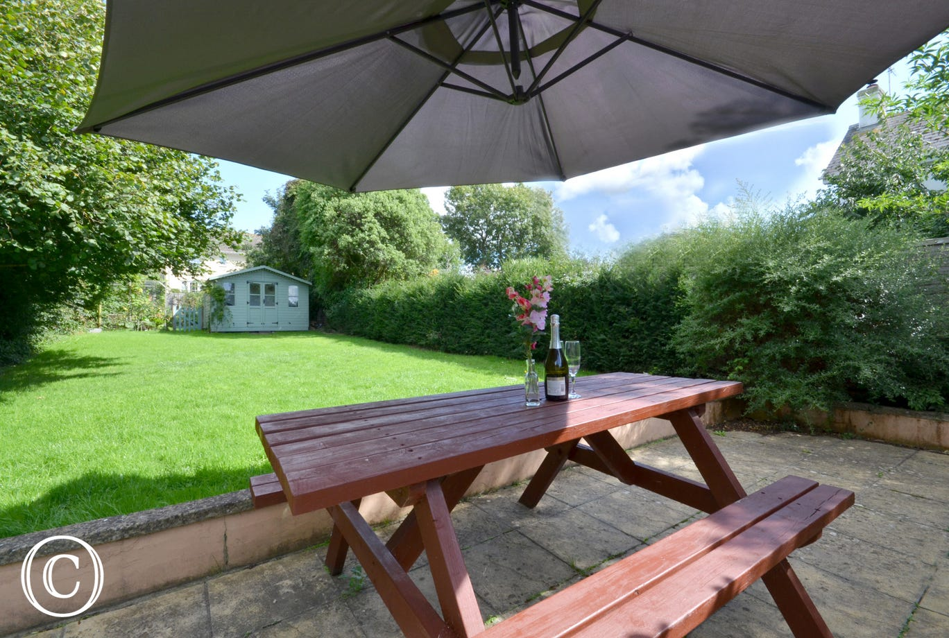 The large enclosed garden with patio area, picnic bench and a good sized lawned area, ideal for children's play
