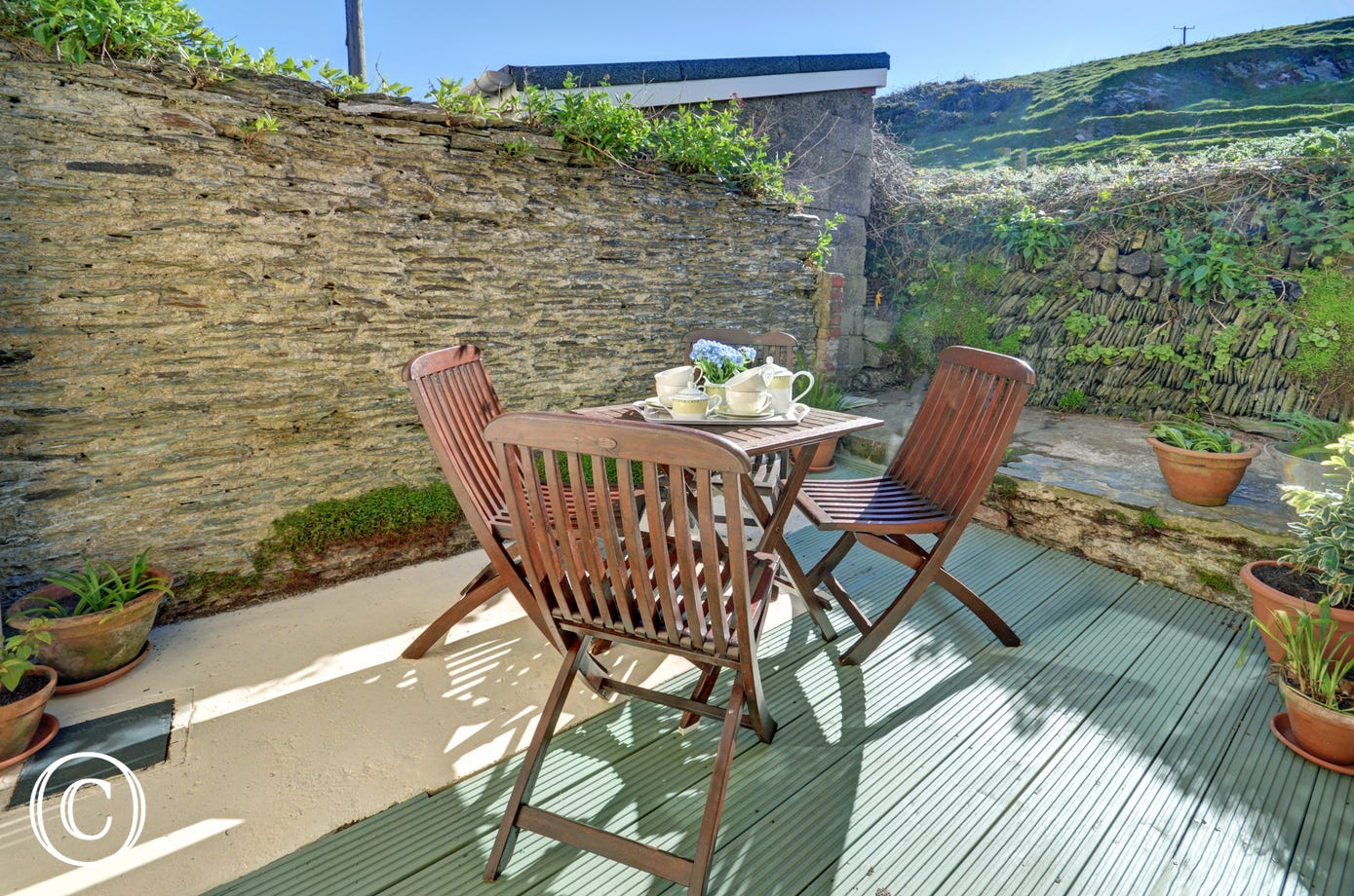 A rural aspect is enjoyed from the rear as the cottage backs onto National Trust countryside
