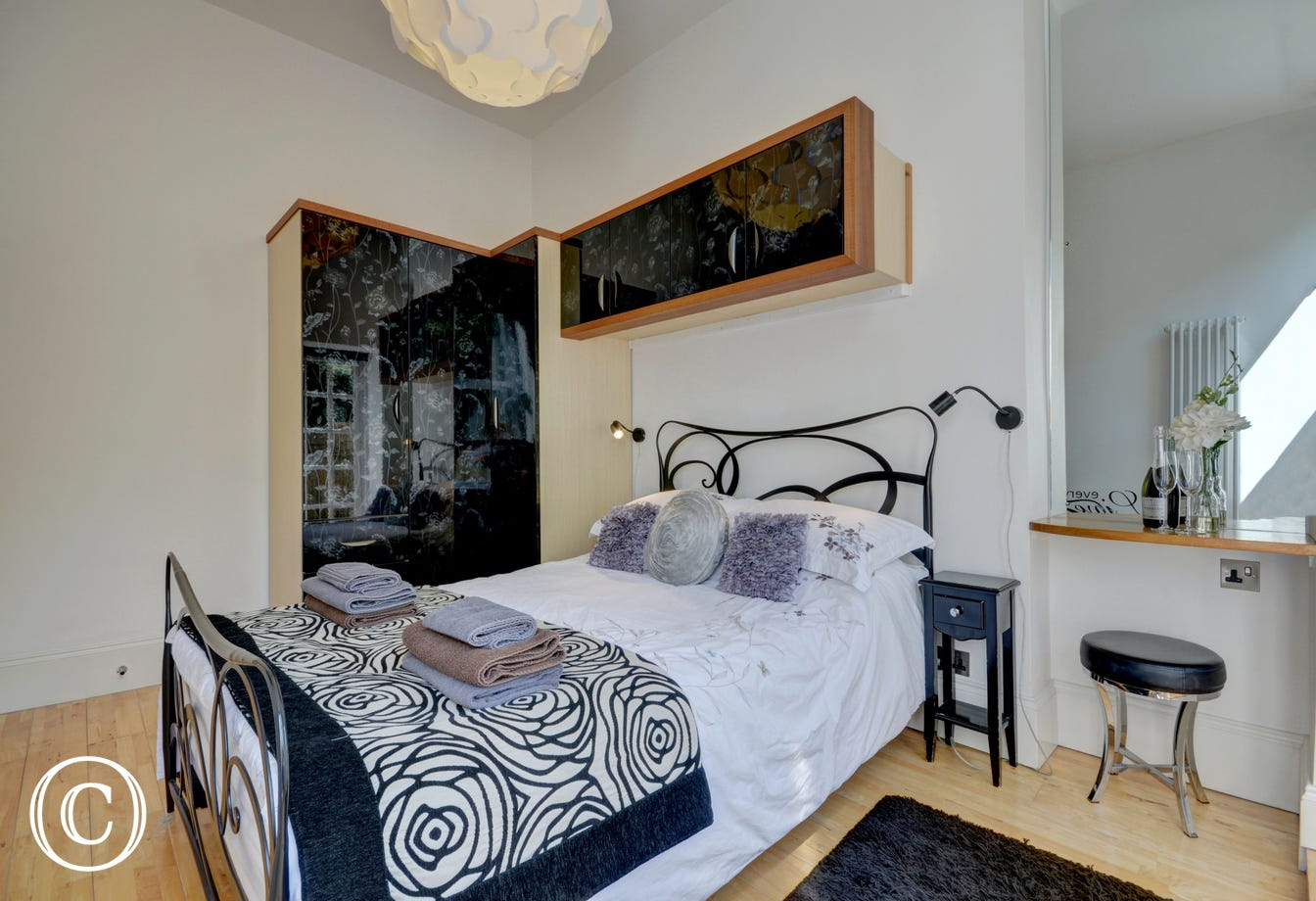 The double bedroom with dressing table and ample wardrobe space