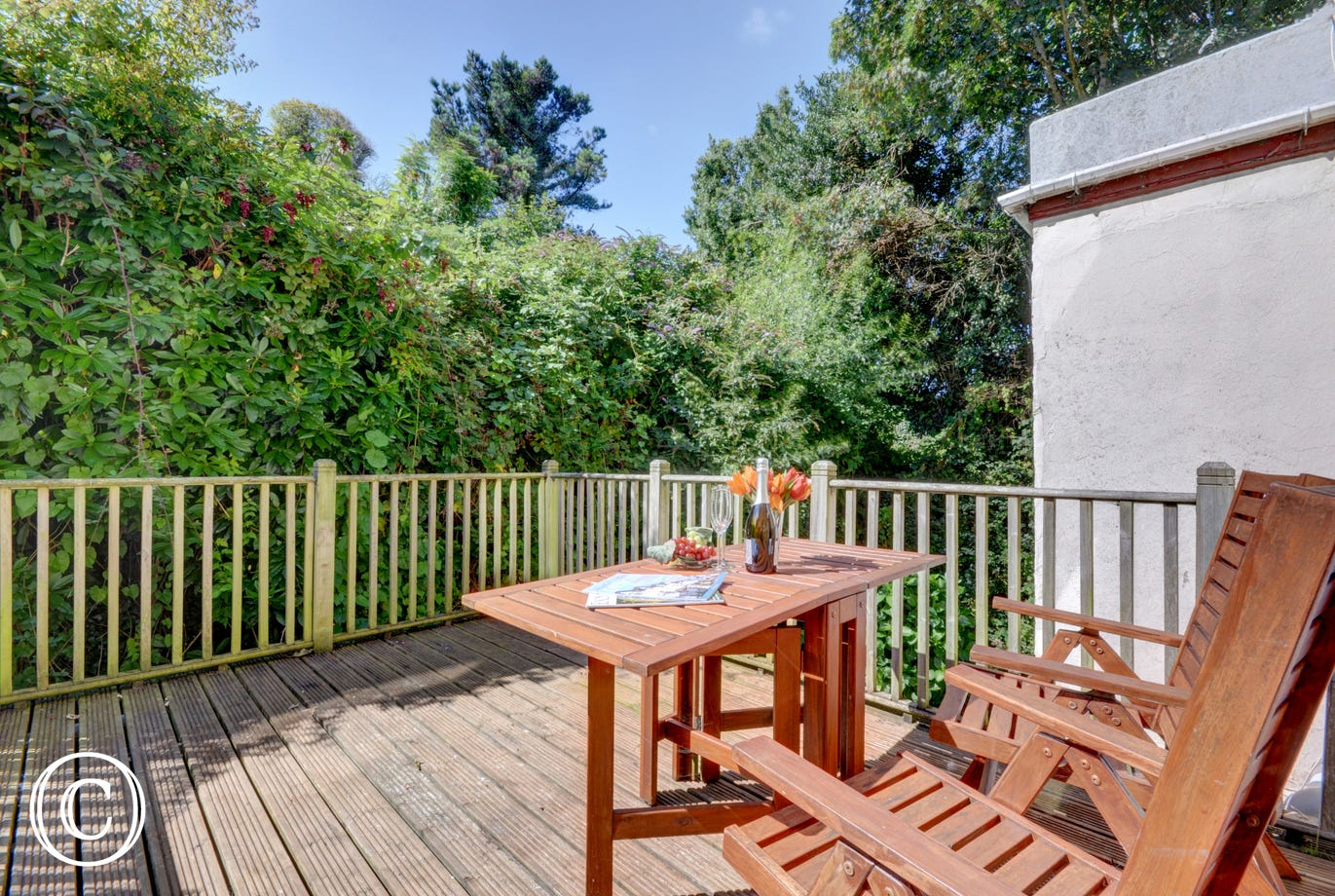The south facing private rear decked patio where you can eat al fresco in the sunshine