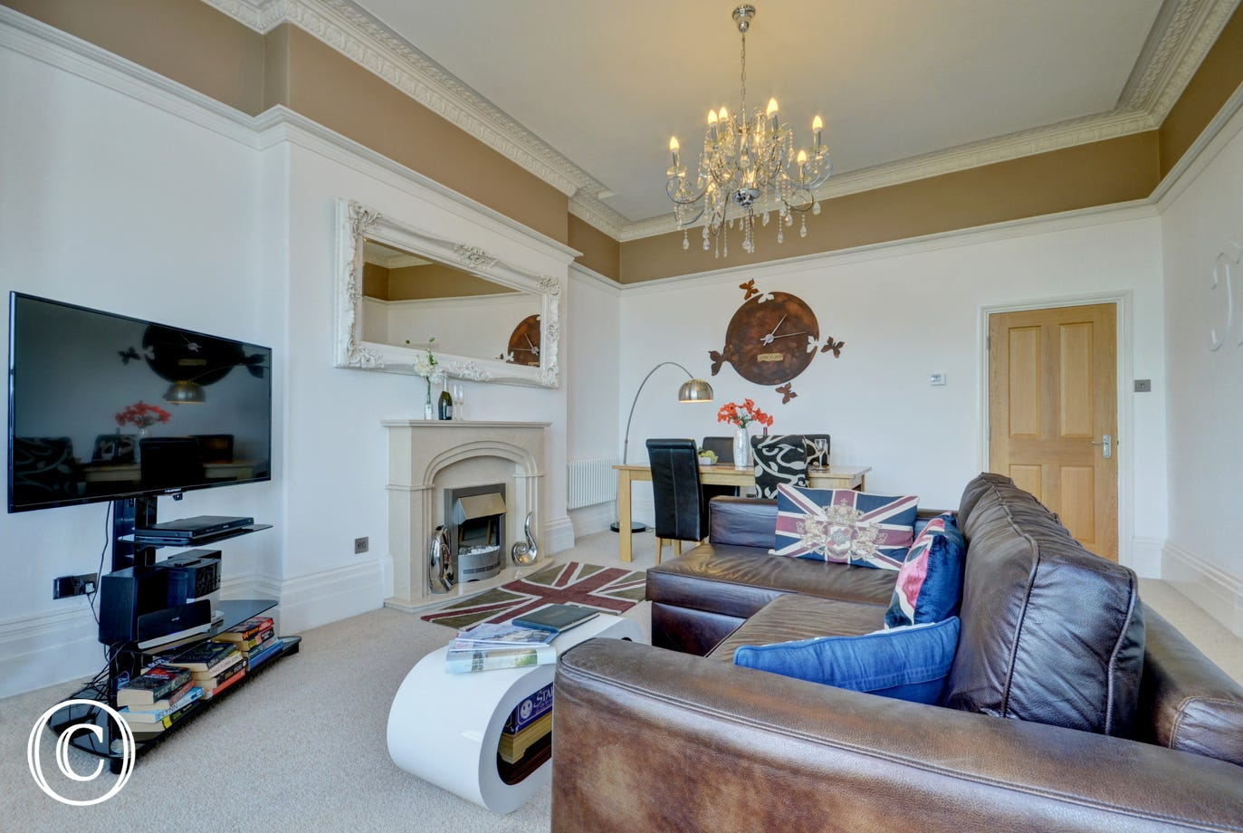 Comfortable seating and large TV in the lovely bright living space