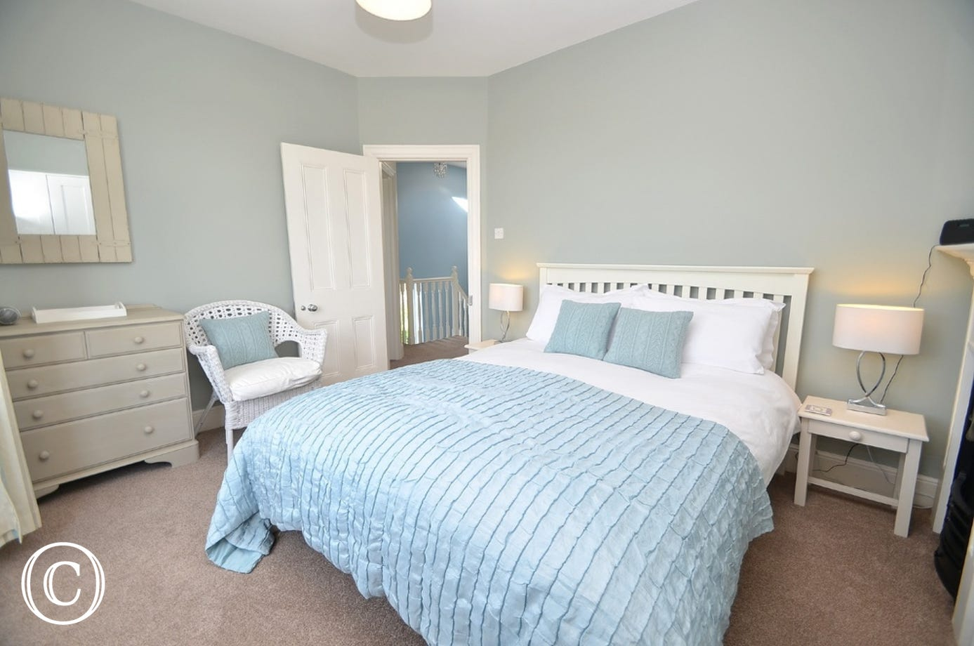 Master bedroom: Kingsize bed, matching bedside tables and one-touch lamps, a cushioned window seat with views over the River Dart. Single wardrobe, chest of drawers.