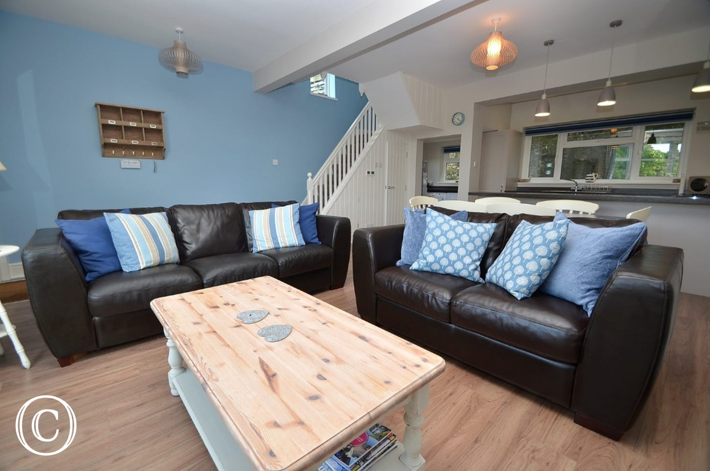 Living/Dining: Open plan and tastefully decorated, window seat with views over the river, two large leather sofas, coffee table, table lamp, large flatscreen TV and dvd player. A selection of games and dvd's available.  Underfloor heating.