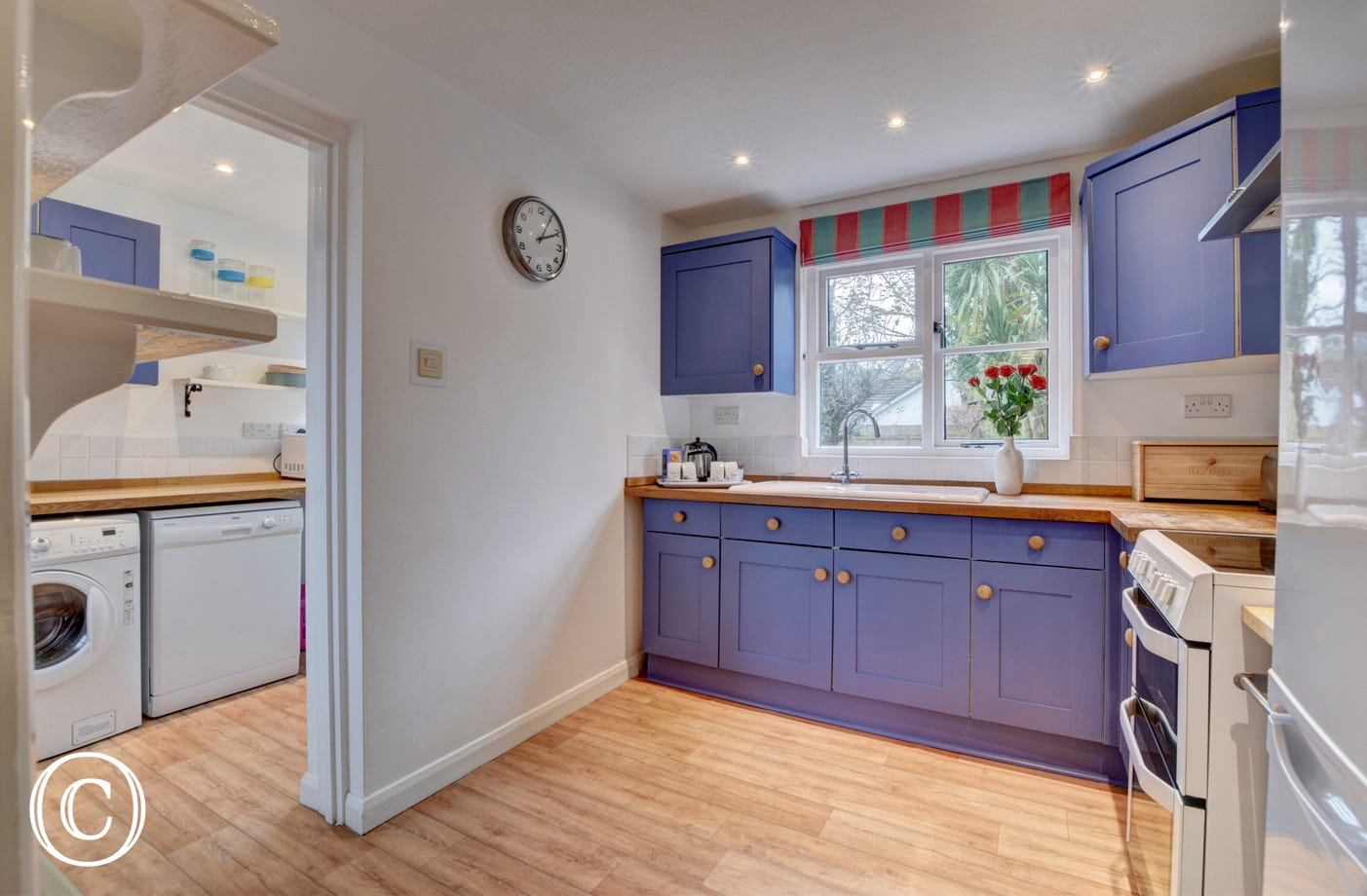 The well equipped kitchen and utility room have everything you need