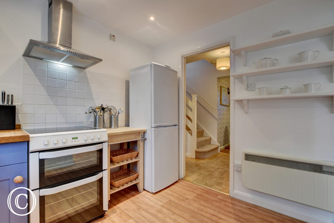 Kitchen with electric cooker, microwave and fridge/freezer