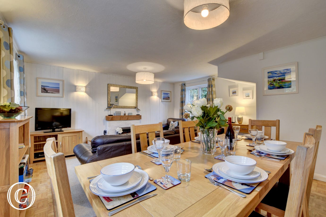 The large dining table is perfect for family meals together