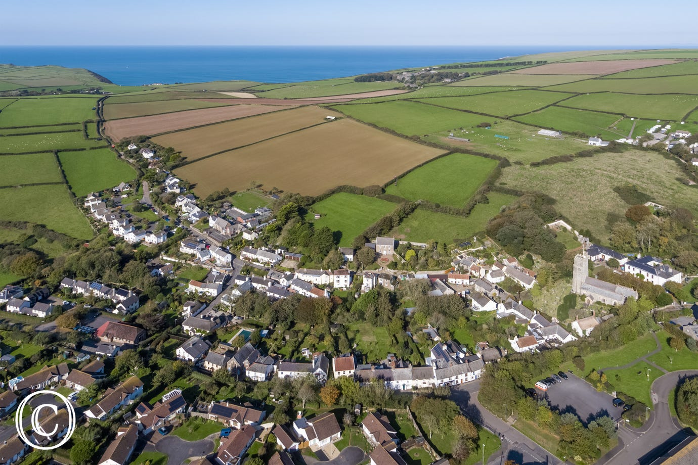 Georgeham is a picturesque North Devon village with two popular pubs and just a short drive to the famous surfing beaches of Putsborough and Croyde