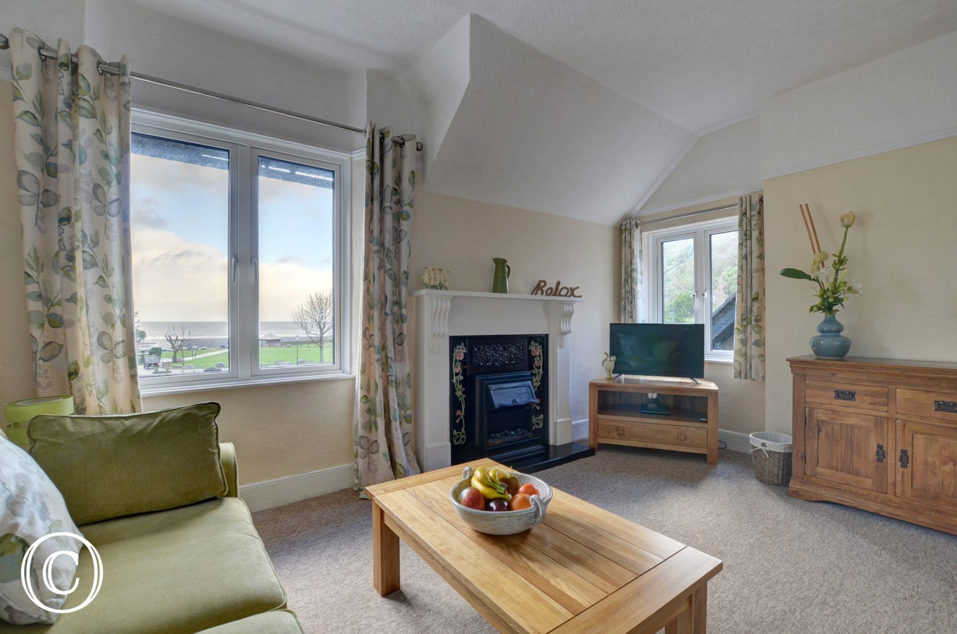 The spacious living room with lovely dual aspect views