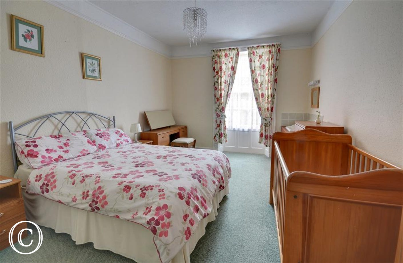 Large double bedroom with plenty of room for a cot