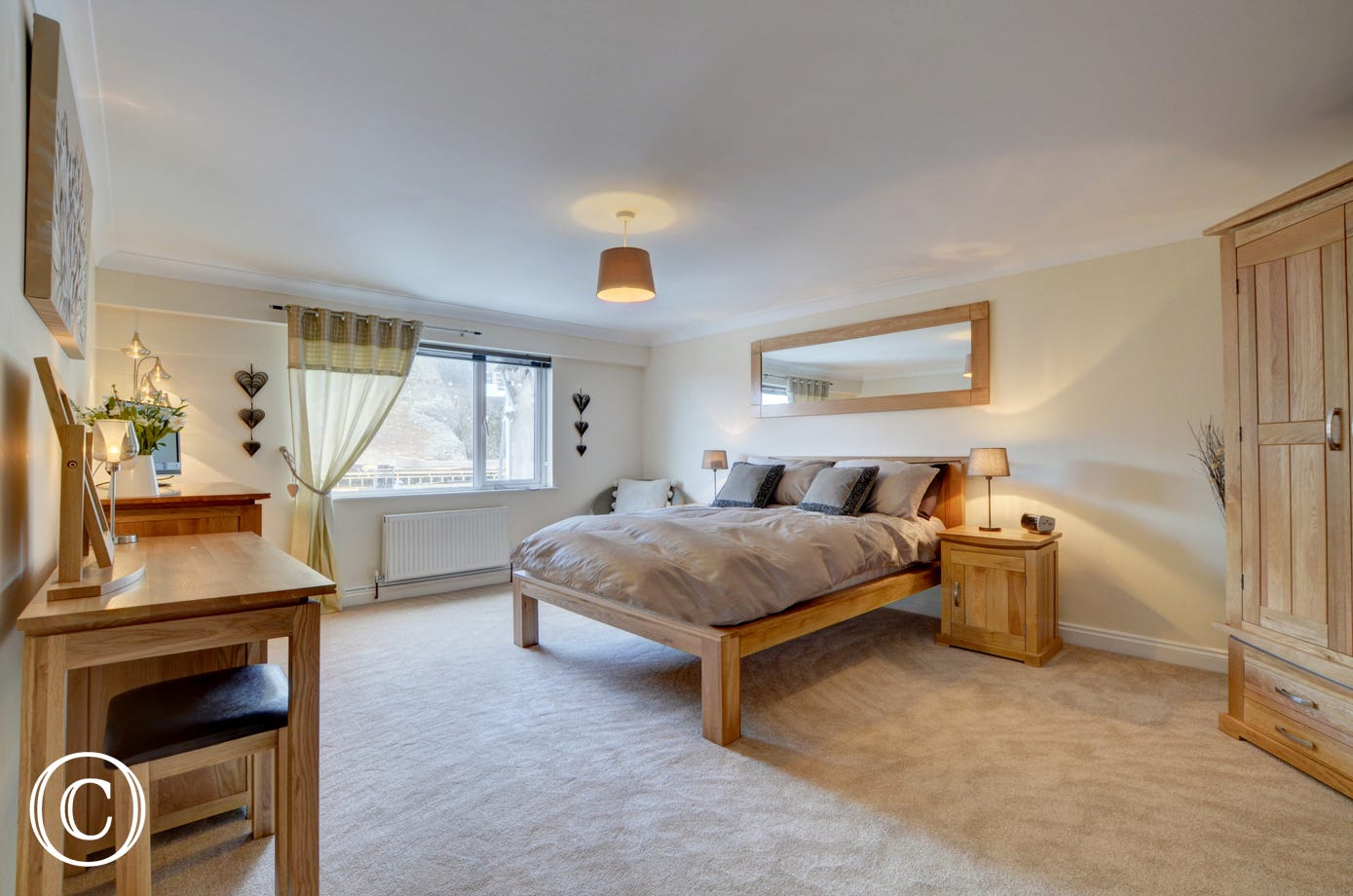 The super stylish master bedroom which benefits from a contemporary ensuite bathroom