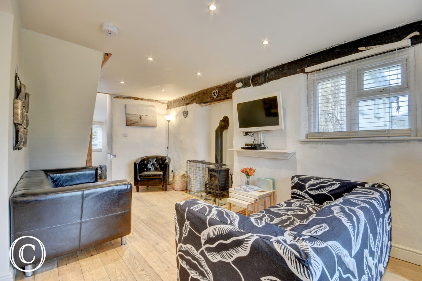 The cottage has open plan living on the ground floor with real wood floors