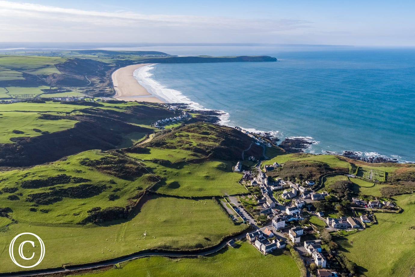An aerial view of Woolacombe beach and nearby Mortehoe