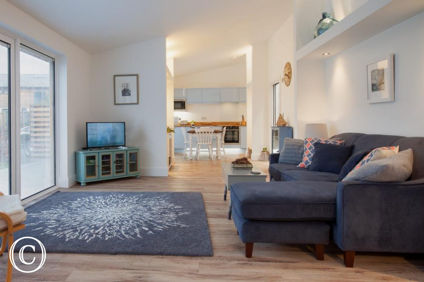 Hygge House, Shaldon - Living area with sofa and television