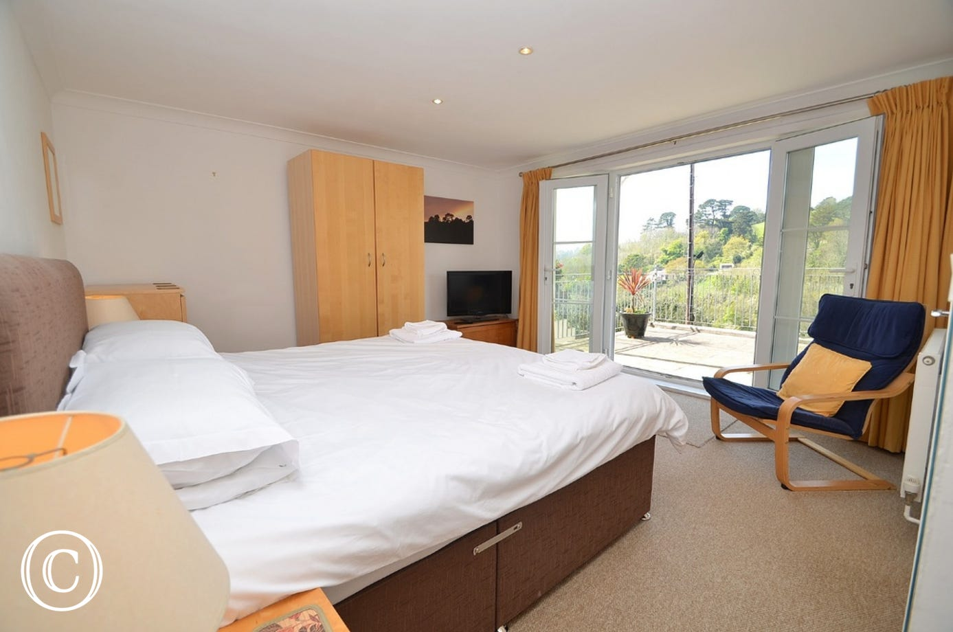 Master Bedroom: Super-king size bed, double wardrobe, chest of drawers and chair, modern white en-suite shower room, slate floor and double patio doors onto terrace area.