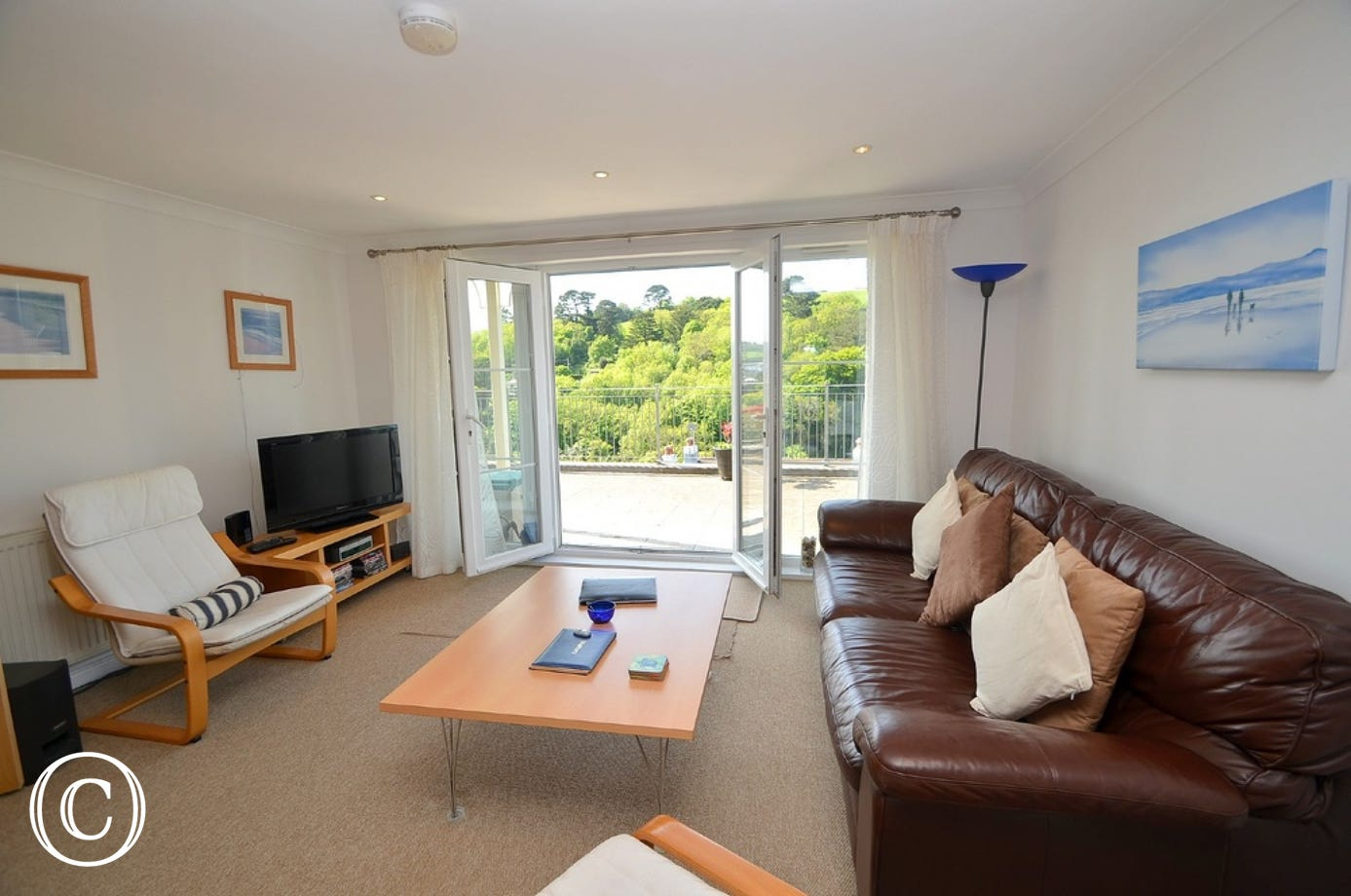 Living area: Stylish and modern open plan living, kitchen and dining area with fabulous views over the River Dart. Three seater sofa and two armchairs. Patio doors onto the private furnished terrace area. Flatscreen LCD TV with DVD player, music stereo wi